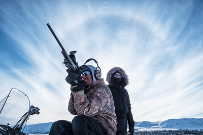 On a hunt 20 miles East of Arctic Village, Brennan (22) uses his scope to scan the nearby mountains for caribou.