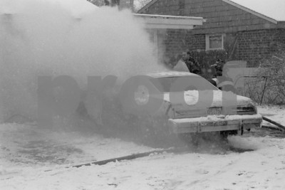 Car Fire in a Snow Storm