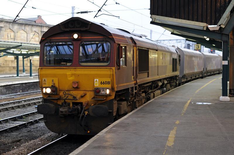 66081, 4S62, Carlisle, Fri 16 November 2012 - 1540.  DB Schenker's 1127 Milford - New Cumnock coal empties arrives at platform 3 immediately after 66951 had left.