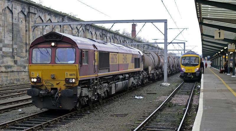 66175 (6C68) & 185132, Carlisle, Fri 16 November 2012 - 1509.  DB Schenker's 1512 Carlisle yard - Workington docks ICA and TEA tanks waits for the road as First TransPennine Express's 1300 Manchester Airport - Glasgow departs.