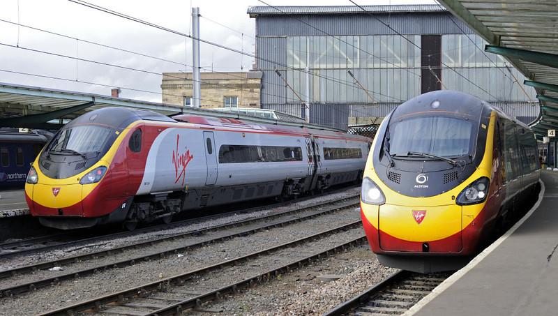 390124 Virgin Venturer (left) & 390107 Virgin Lady, Carlisle, Fri 16 November 2012 - 1251.  Virgin's 0930 Euston - Glasgow and 1140 Glasgow - Euston, both formed of 11 car Pendos..
