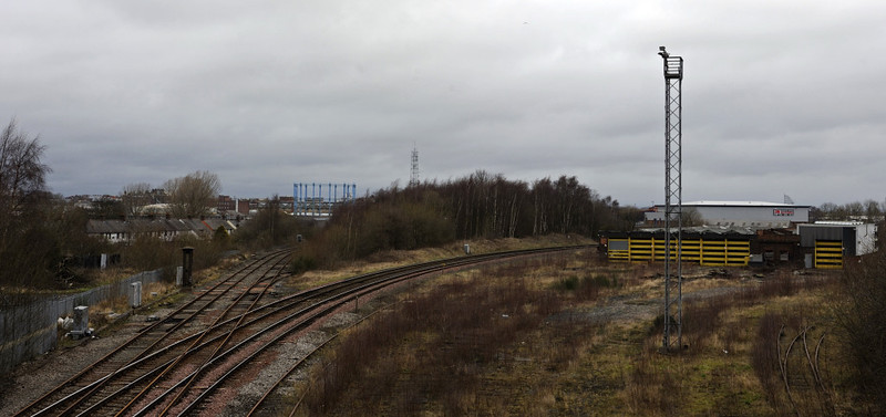 Currock Junction, Carlisle, Thurs 23 February 2012.  Looking north, with the Maryport - Bog Junction goods line at left.  The passenger lines to Citadel sweep right.  The former Glasgow & South Western Rly loco shed is at right.  Opened in 1896, it was converted to a wagon repair depot in 1924 immediately after the formation of the LMS.  It closed in 2007, and is the only Carlisle steam shed to survive.  (There used to be seven.)  Overgrown at centre is Currock yard, site of the Maryport & Carlisle Rly loco shed which was demolished in the 1930s.