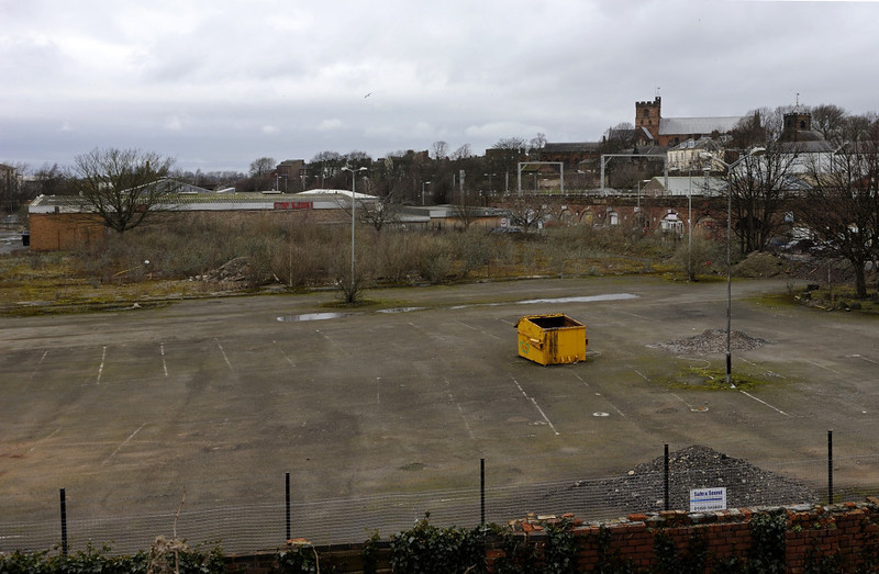 Site of Caledonian Rly Viaduct goods depot, Carlisle, Thurs 23 February 2012.  Looking north, with the River Caldew out of sight at left and the viaduct carrying the WCML from Citadel at right.