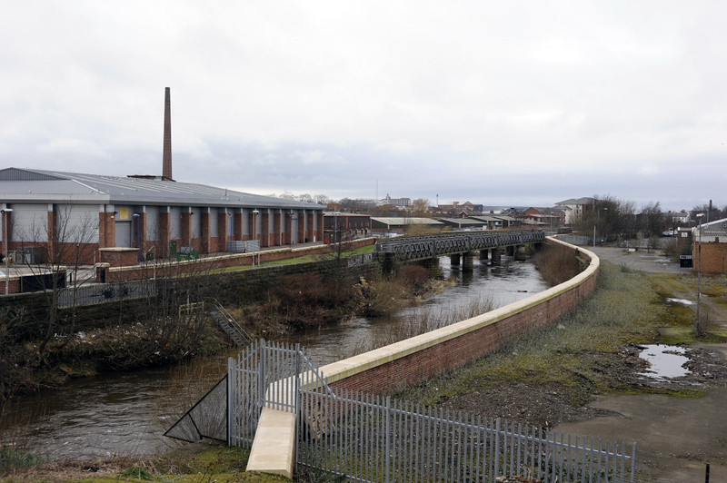 Former goods line bridge over the River Caldew, Carlisle, Thurs 23 February 2012.  Looking north.  The modern building at left is on the site of the Glasgow & South Western Rly's Dentonholme goods depot..  The Caledonian Rly's Viaduct goods depot occupied the site at right.