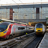 390127 Virgin Buccaneer (9M56) & 43251 (1S11), Carlisle, Tues 30 December 2014 - 1423. Virgin's 1251 Edinburgh - Birmingham - Euston departs 15 minutes late as East Coast's diverted 1000 King's Cross - Aberdeen waits for the road to Edinburgh.  It finally got away at 1438 after waiting for a path behind 390104 then 390136, delayed by a track problem near Warrington.  43309 was on the other end. The 1000 ex King's Cross used to be known as the Flying Scotsman.