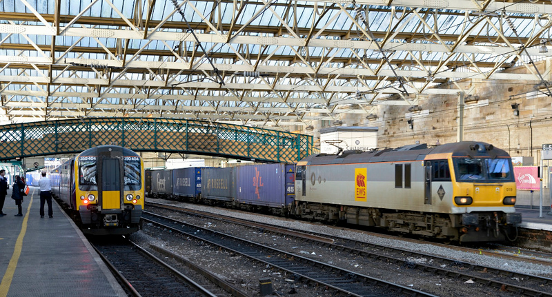 350404 (1S51) & 92019 Wagner (4M10), Carlisle, Tues 30 December 2014 - 1317.   FTPE's 1100 Manchester Airport - Glasgow gets the right away as DRS's 1101 Coatbridge - Daventry passes 35 minutes early.