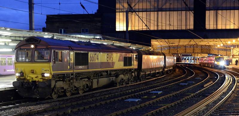 66174 (6E95) & 185101 (1M91), Carlisle, Wed 5 Ferbaury 2014 - 1732.  DB Schenker's 0956 Greenburn - West Burton power station coal stands in platform 3 as First TransPennine Express's 1612 Edinburgh - Manchester Airport arrives in platform 4.