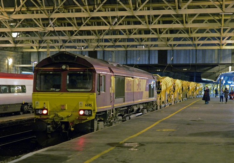 6H95, Carlisle, Wed 5 February 2014 - 1800 2.  66115 was dead; the train was being hauled by 66197.  Virgin's 1M17 1640 Glasgow - Euston is in platform 4.  The HOBC train consist (from the rear) was 66115, DR92441, DR92453. DR92438. DR92462. DR92464. DR92463. DR92461. DR92467. DR92445. DR92472, DR92457, DR92448, DR92446, DR92455, DR92433, DR92439, DR92432, DR76801, DR76503, DR92431, DR92456, DR92454, DR92468, DR92465, DR92471, DR92459, DR92440, DR92452, DR92458, DR92466, DR92451, DR92450, DR92443, DR92434, DR92442, DR92436, 7093010013 & 66197.