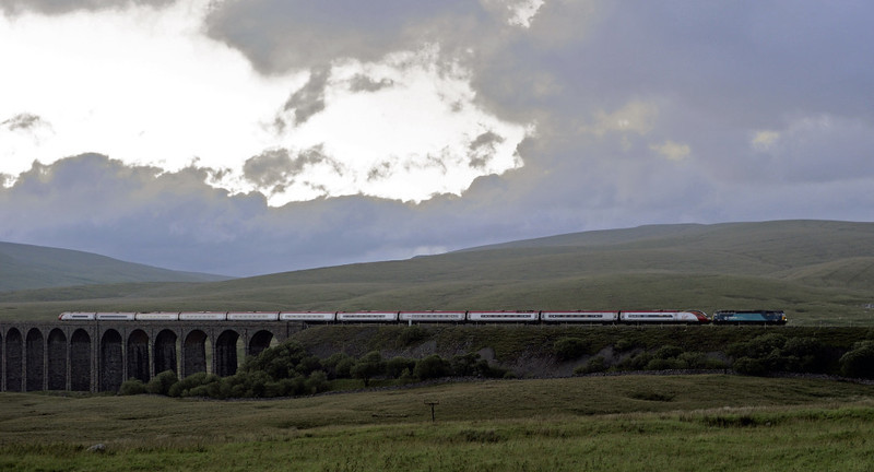 57314 & 390137 Virgin Difference, 1M19, Ribblehead, Thurs 28 June 2012 - 2205.  Virgin's 1840 Glasgow - Euston, diverted because of flooding near Tebay and Oxenholme.  The 57 dragged the 11 car Pendo from Glasgow via Beattock to Preston, where it arrived at 2331 (due 2058).  The Pendo eventurally reached Euston at 0403, 265 mins late.
