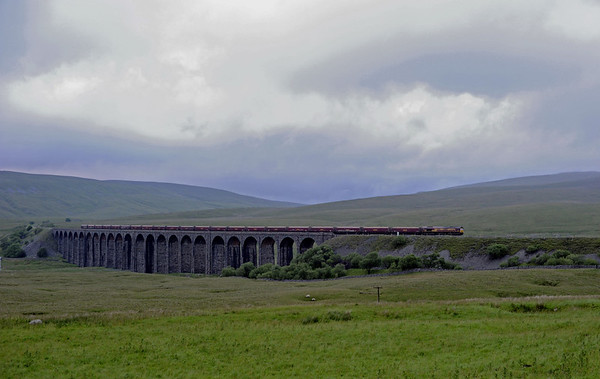 66102, 6E99, Ribblehead, Thurs 28 June 2012 - 2112.  28 June was a day of heavy rainstorms, and the resulting landslips and washouts caused severe disruption on the Anglo-Scottish lines.  The WCML was blocked near Oxenholme and at Tebay, the ECML near Berwick, and the Newcastle - Carlisle line near Haltwhistle.  Rather surprisingly, the Settle & Carlisle was unscathed, and here is DB Schenker's 0956 Greenburn - Cottam power station coal crossing the viaduct.