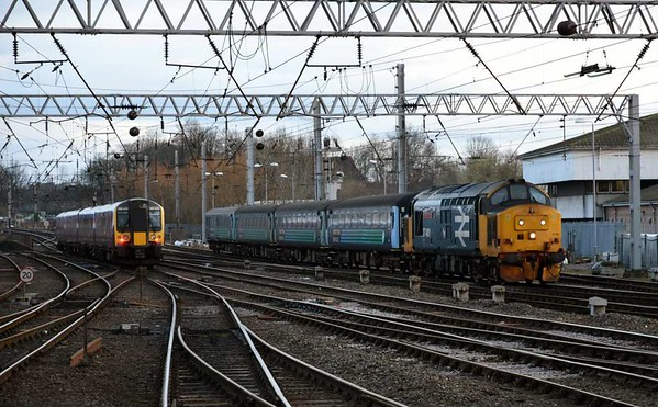 350410 & 37401 Mary Queen of Scots, Carlisle, Wed 1 March 2017 - 1737.   FTPE's 1M91 1612 Edinburgh - Manchester Airport departs as Northern's 2C41 1437 Barrow - Carlisle arrives 7 late.  Its consist was 6122, 6008, 6173 & DBSO 9709, and it returned to Barrow 4 late from platform 1 at 1741 (2C42).