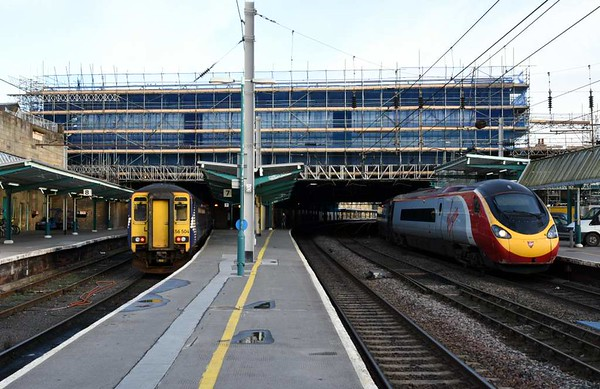 Roof replacement, Carlisle, Wed 1 March 2017 1 - 1646.  Showing the scaffolding at the northern end of the station while the roof was being replaced.  390112 Virgin Star was working Virgin's 1S69 1330 Euston - Glasgow.  156504 was stabled between turns.