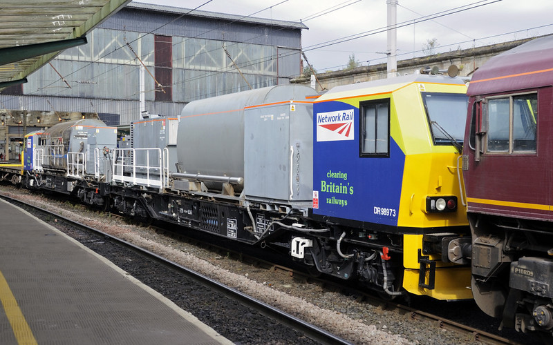 DR 98973 / 923, 6K05, Carlisle, Fri 14 September 2012 - 1235.  The Network Rail Multi Purpose Vehicles were hitching a lift to Crewe.