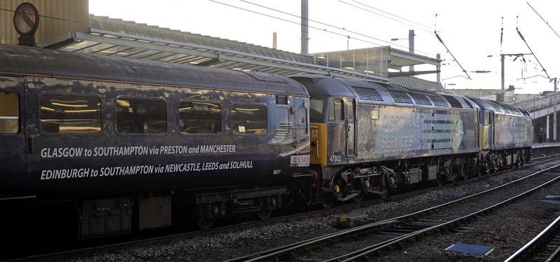 47805 & 47802 Pride of Cumbria, 1Z84, Carlisle, Fri 14 March 2012 - 1825.  The Southampton - Glasgow Cruise Saver arrives, 40 minutes late.  Its 12 coaches were 9537, 9520, 3336, 3330, 1683, 3390, 3364, 3356, 80042, 3397, 3348 & 3417.