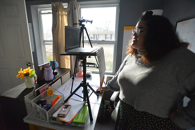 Walton Fellow Maria Martinez has set up a virtual workspace in a corner of her bedroom at her Lawrence home.