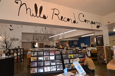 At Mills Records, those are managers Peter Williams, left, and Dylan Pyles working while customer Sam Caballero thumbs through the vinyl.  In the other  pix, that is Caballero looking through the albums. He is not an introvert. He works someplace where he interacts with a lot of people and is very comfortable right now going out and about. May 2021