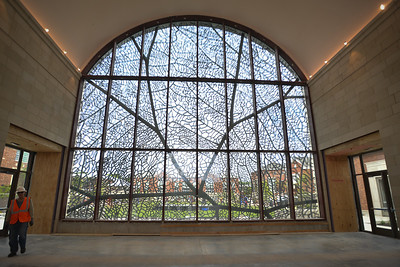 Viewed from inside the dining hall at Pembroke HIll, Jan Hendrix'sstainless steel design can be viewed from a variety of angles creating multitudes of appearances. The piece was fabricated by Kansas City-based Zahner Metal Conservation.