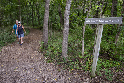 Ruthi and Gary Rahmlow hike the Old Kate and Waterfall Trail at Parkville Nature Sanctuary on Aug. 26, 2021.