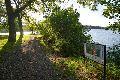 The nature trail behind the F.L. Schlagle Environmental Library takes hikers on a short, shady walk with a view of the water.