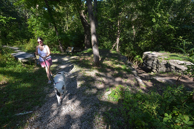 Kansas City resident Vanessa Brown walks with Valentine on a hike along Fox Hollow Trail in Swope Park on Aug. 24, 2021.