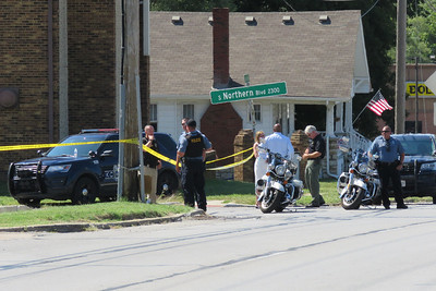 Law enforcement officers work the scene in the 2200 block of Northern Blvd. in Independence on Wednesday, Sept. 15 2021.