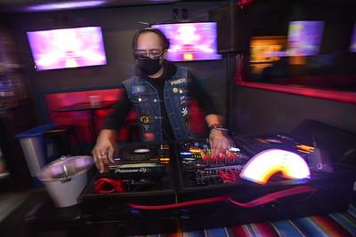 DJ Adam Gonzales pumps out music inside Woody's KC on April 1, 2020.