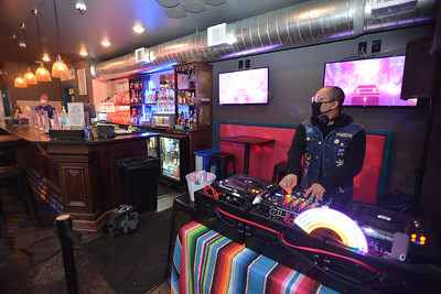 DJ Adam Gonzales pumps out music at Woody's KC on April 1, 2020.