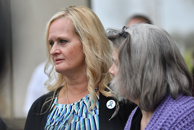 Jamie Runions, left, and Rhonda Beckford talk outside Cass County Courthouse on Friday after Kylr Yust was sentence to 15 years for manslaughter of their daughters.