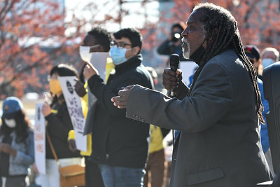 """Quadafi, the unofficial mayor of the homeless encampment at city hall, addresses the crowd on the south side of Kansas City's city hall Thursday afternoon at a joint """"We shall not be moved"""" rally with KC Tenants."""