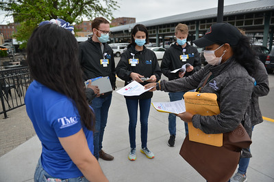 Truman Medica Centers/University Health employees visit businesses in River Market. They were trying to get people to schedule vaccinations for their employees.