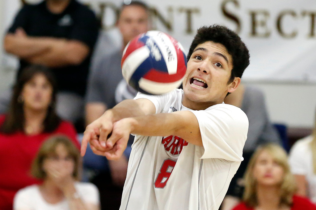 . Carmel\'s Joaquin Buenrostro digs against  Harker during the CCS boys volleyball championship at St. Francis in Mountain View on Saturday May 12, 2018. Carmel won the match 3-2. (David Royal/ Herald Correspondent)