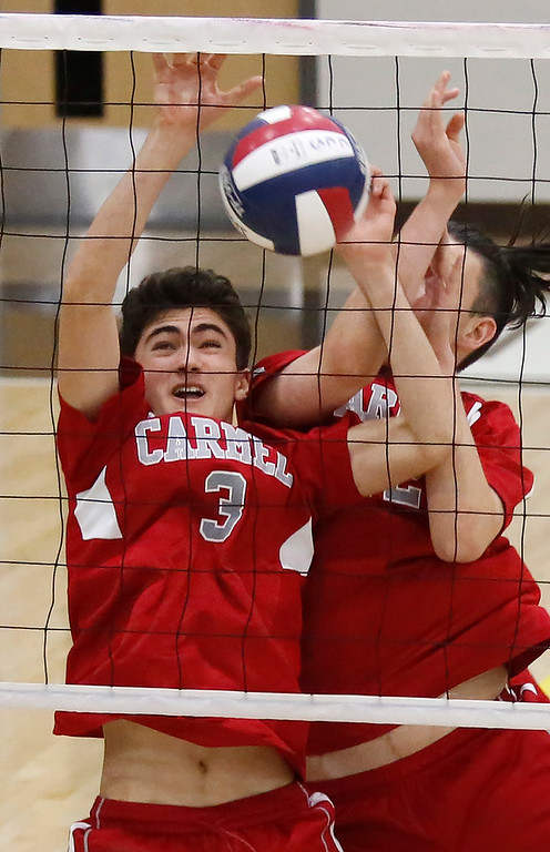 . Carmel\'s Charlie Delapa and Aidan Westerman collide while blocking against  Harker during the CCS boys volleyball championship at St. Francis in Mountain View on Saturday May 12, 2018. Carmel won the match 3-2. (David Royal/ Herald Correspondent)