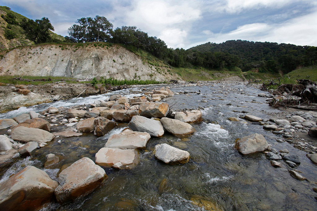 . Last Winter\'s storms generated large flows that rearranged the new Carmel River channel with step pools and resting pools at the former San Clemente Dam site on Wednesday, April 26, 2017.  The step pool design was constructed with thousands of boulders and is designed to facilitate fish passage up river.   (Vern Fisher - Monterey Herald)