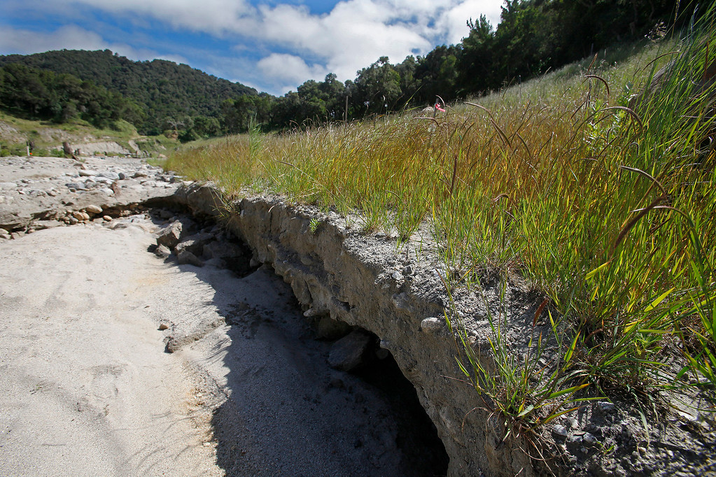 . Erosion from last Winter\'s storms that generated large flows that rearranged the new Carmel River channel with step pools and resting pools at the former San Clemente Dam site on Wednesday, April 26, 2017.  The step pool design was constructed with thousands of boulders and is designed to facilitate fish passage up river.   (Vern Fisher - Monterey Herald)