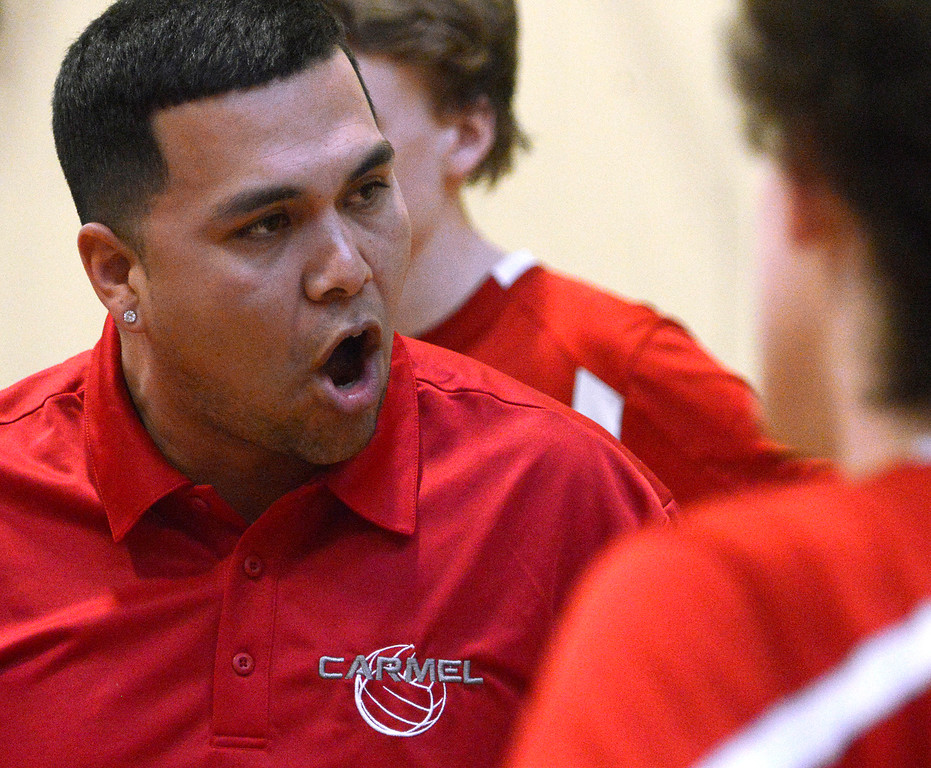 . Carmel coach Israel Ricardez speaks with his team during boys volleyball against Monterey in Monterey on Tuesday April 11, 2017. (David Royal - Monterey Herald)