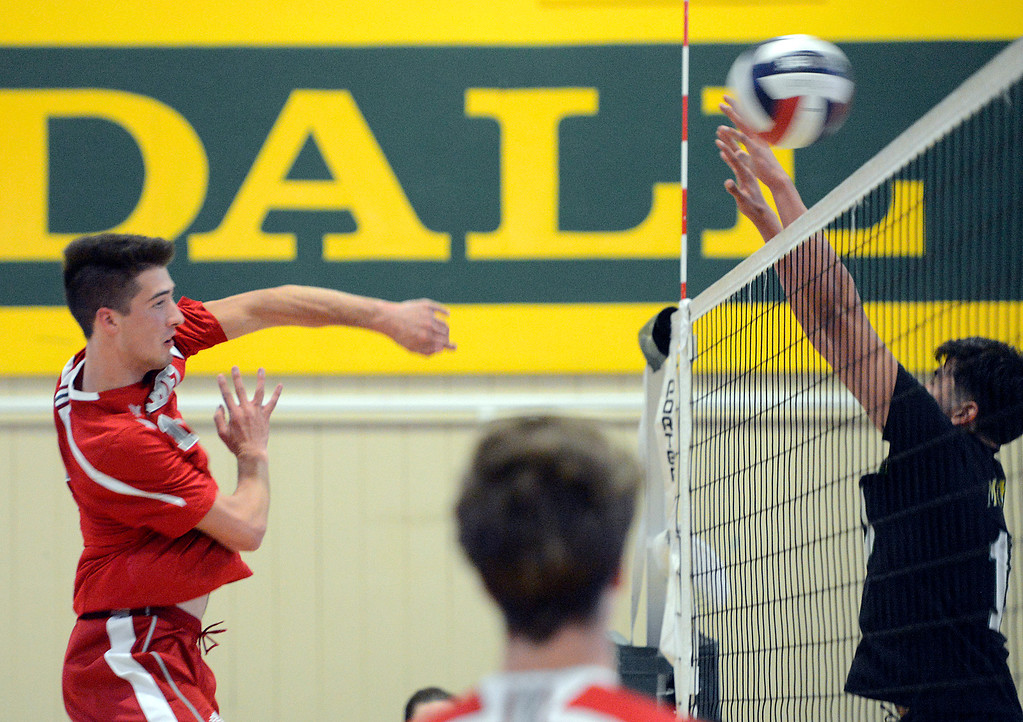 . Carmel\'s Jared McNally hits the ball across during boys volleyball in Monterey on Tuesday April 11, 2017. (David Royal - Monterey Herald)