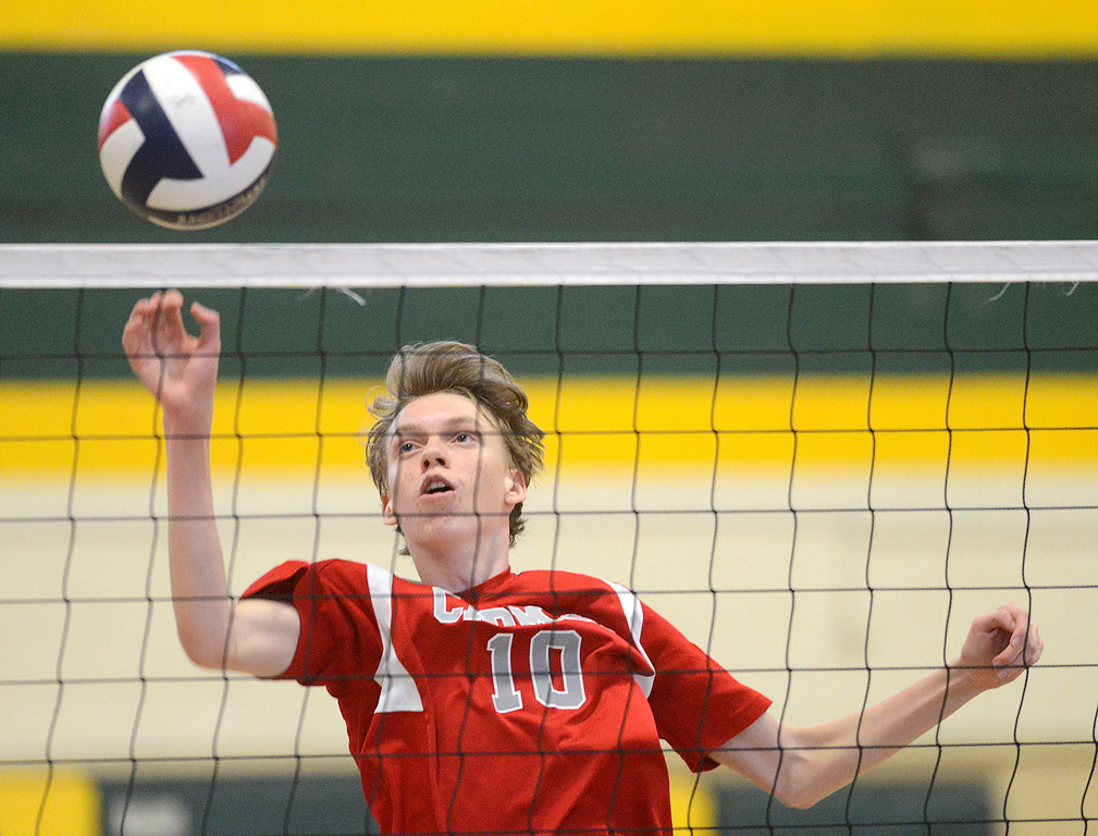 . Carmel\'s Cole Dickman hits the ball across during boys volleyball against Monterey in Monterey on Tuesday April 11, 2017. (David Royal - Monterey Herald)