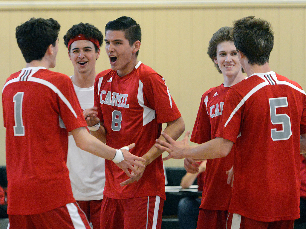 . Carmel players celebrate after winning a tough volley during boys volleyball against Monterey in Monterey on Tuesday April 11, 2017. (David Royal - Monterey Herald)