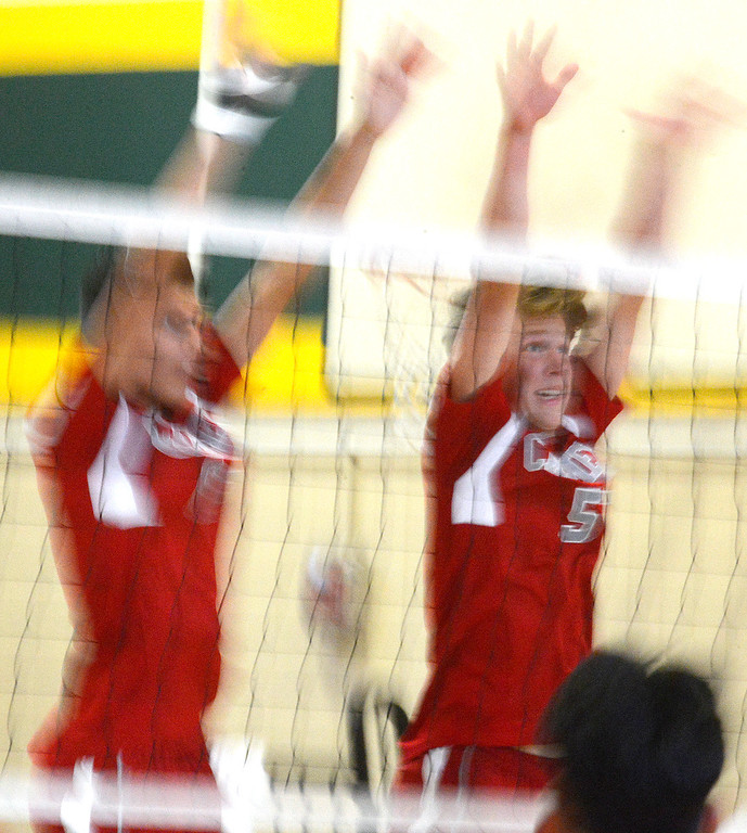 . Carmel\'s Ben Airola, right, and Alessandro Boreo block during boys volleyball against Monterey in Monterey on Tuesday April 11, 2017. (David Royal - Monterey Herald)