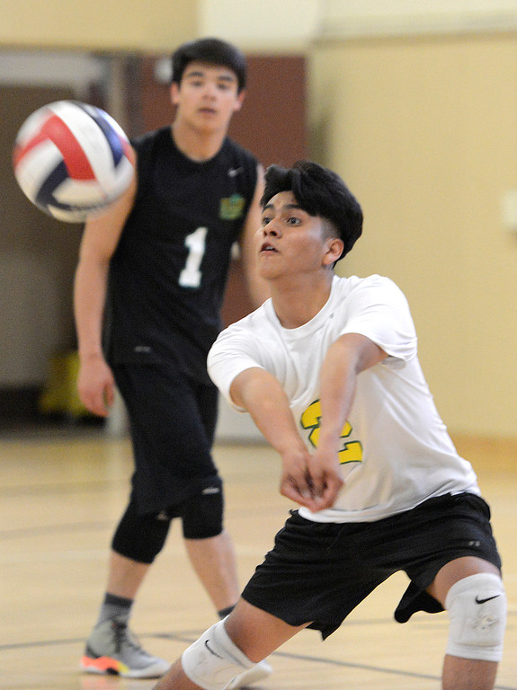 . Monterey\'s Alan Cruz digs the ball during boys volleyball against Carmel in Monterey on Tuesday April 11, 2017. (David Royal - Monterey Herald)