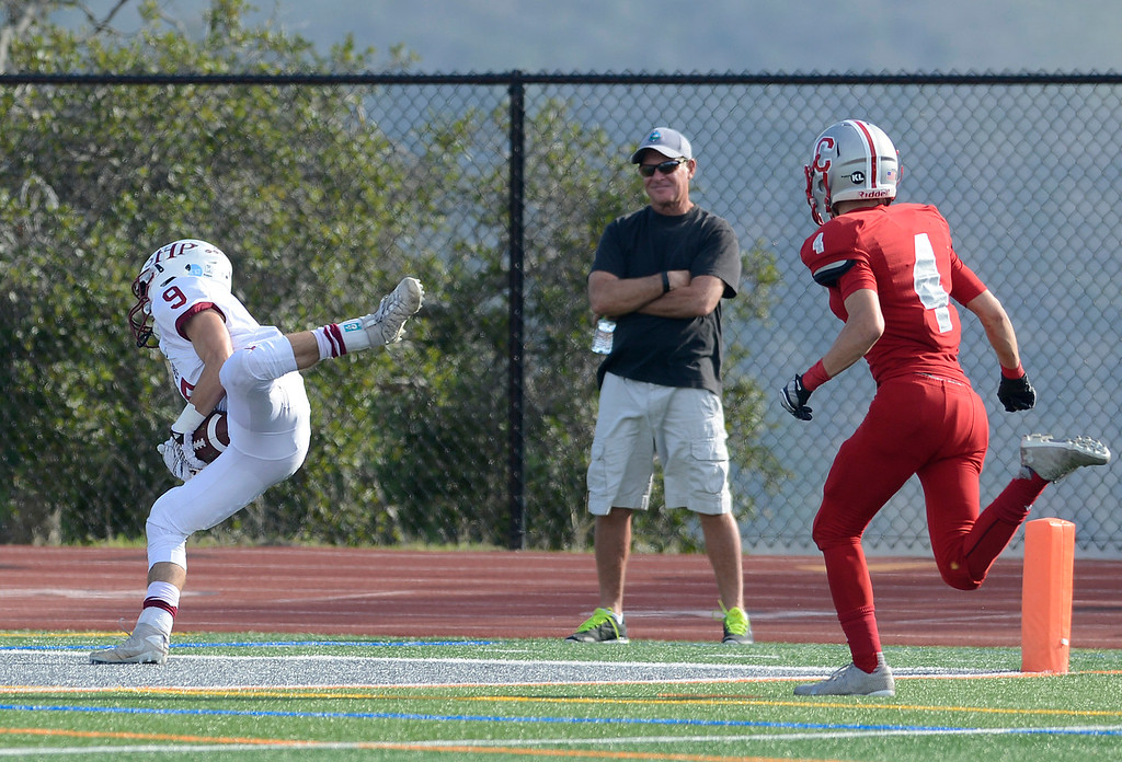 . Sacred Heart\'s Alex Harper reels in a touchdown pass during CCS Division V football playoffs in Carmel on Saturday November 12, 2016. David Royal - Monterey Herald)