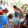 sorting and compiling gift bags <br /> photo by Tara Kolker