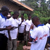 Education team praying for villagers