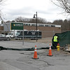 Workers put up fencing with a green tarp around the Carmelita Landry Arena at the Wallace Civic Center at Fitchburg State University Wednesday, April 1, 2020. They also put up some orange fencing in front of the metal fence to also help keep people at a distance from the ice rink. SENTINEL & ENTERPRISE/JOHN LOVE
