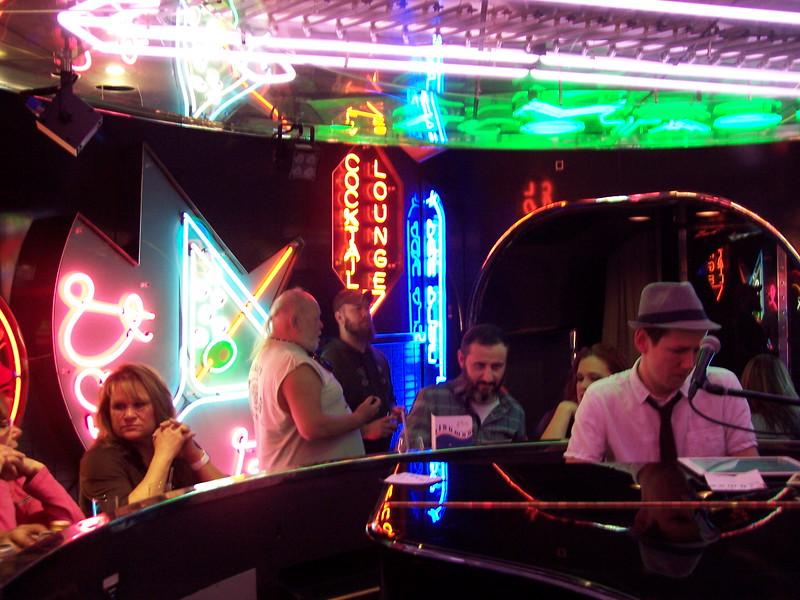 Sam plays the grand piano