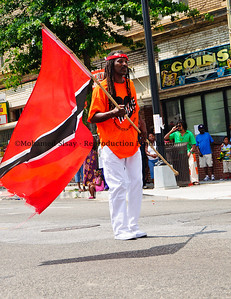 Repping Trinidad. This man is holding the flag with pride.
