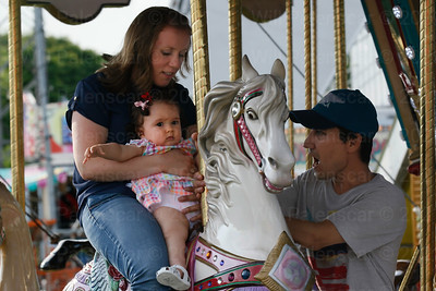 9 month old Luna on her first amusement ride with mother Justyna and father Willy