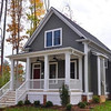 The Broad River Cottage Plan by Allison Ramsey Architects built at New Town in Williamsburg, VA. This plan is 1507 Heated Square Feet, 3 Bedrooms & 2 1/2 Bathrooms. Carolina Inspirations Book I, Page 69, C0028.