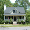 The Coosaw River Cottage by Allison Ramsey Architects built at Battery Point in Beaufort, South Carolina. This plan is 1705 Heated Square Feet, 3 Bedrooms & 2 1/2 Bathrooms. Carolina Inspirations Book I, Page 63, C0030.