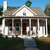The Coosaw River Cottage by Allison Ramsey Architects built on Fuller Street in Beaufort, South Carolina. This plan is 1705 Heated Square Feet, 3 Bedrooms & 2 1/2 Bathrooms. Carolina Inspirations Book I, Page 63, C0030.